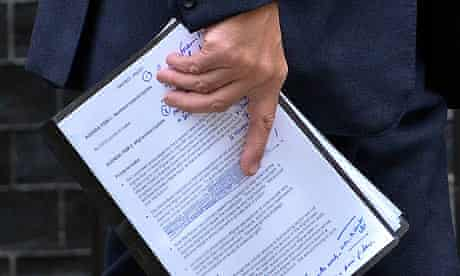 Andrew Mitchell leaves Downing Street holding his briefing notes