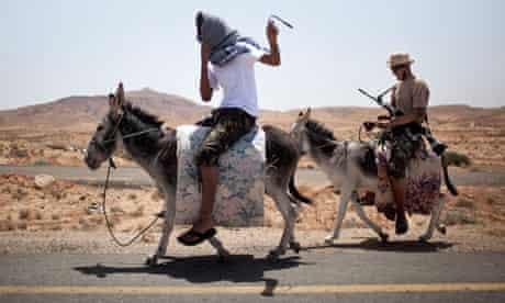 Libyan rebels ride donkeys to reach their comrades