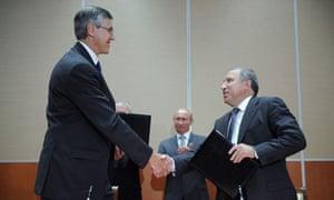 Rosneft's chief executive Eduard Khadainatov, right, and ExxonMobil's President Neil Duffin