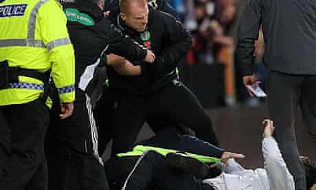 The attack on Celtic's Neil Lennon at Heart of Midlothian's ground, in May.