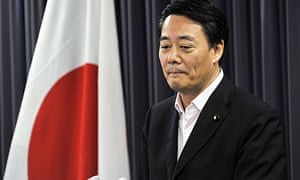 Japan's trade minister Banri Kaieda says he will sack three officials over nuclear policy, in Tokyo.