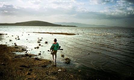 A child walks near lake Naivasha in the Rift Valley, Kenya