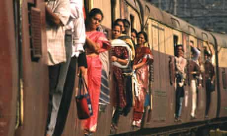 MDG : Morning train commuters on a train bound for Mumbai, India