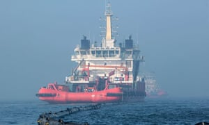 A ship cleans up the leaking oil near the platform C in Bohai Sea, China