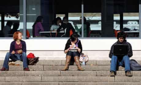 University students sitting on steps