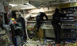 Looters ransack a shop in Hackney, London, 2011