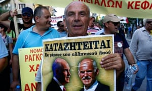 A Greek man protests against prime minister George Papandreou during a rally in Thessaloniki