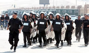 Anti-riot police  at the police academy during the trial of ex president Hosni Mubarak, in Cairo