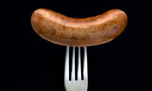 a sausage on a fork