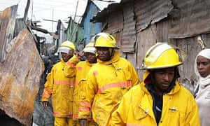 Rescuers arrive at the scene of the fire at a slum in Nairobi.