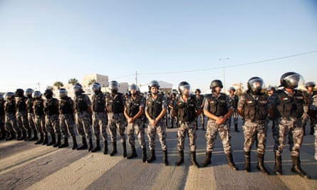 Jordanian riot police guard the US embassy during a protest last week, in Amman.