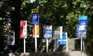 A row of for sale, to let and auction property signs in Birmingham