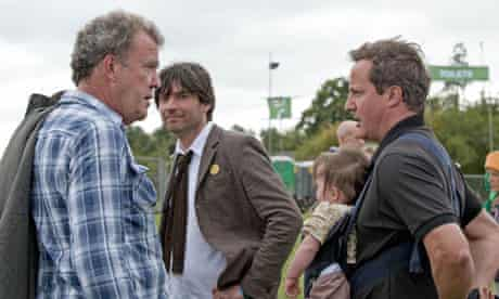 Alex James looks on as Jeremy Clarkson talks to David Cameron