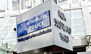 Metropolitan Police sign outside New Scotland Yard, London