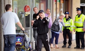 Greater Manchester Police in Salford shopping city a week on from the riots.