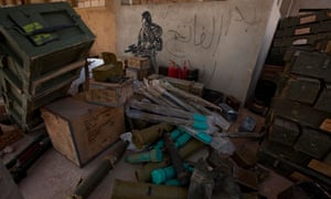 Rebel fighters plunder arms and ammunition from an army base in Ajdabiya, Libya, in March 2011