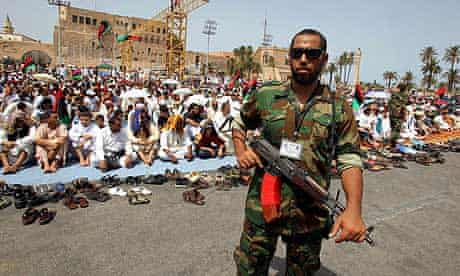 Libyan rebels claim to have captured a top Gaddafi aide.