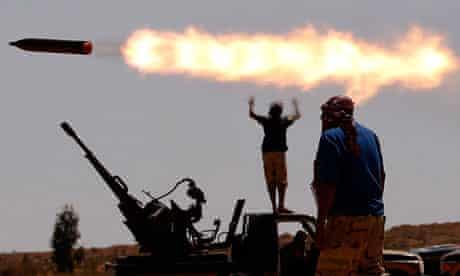 Anti-Gaddafi fighterss in village outside Sirte, Libya