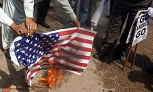 Anti-US protesters in Hyderabad burn a mock US flag