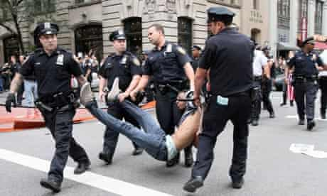 NYPD officers carry away a man during a Wall Street protest.