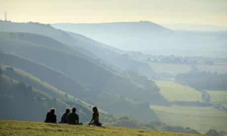 People enjoying the view from near the Devil's Dyke, on the South Downs, Sussex