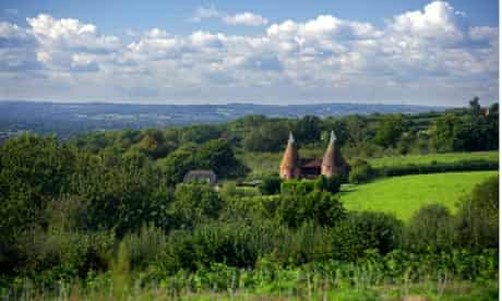View over Kent countryside to the High Weald, with Oast Houses at Ulcombe
