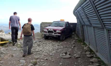 A vehicle parked at the top of Snowdon