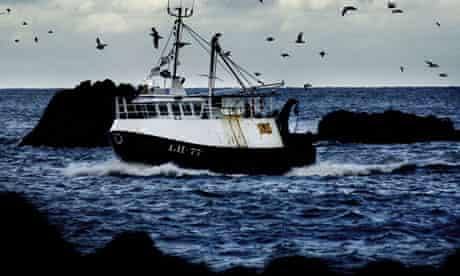 A fishing boat returns to the Scottish east coast