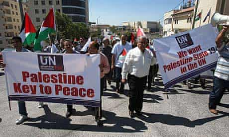Palestinians rally outside the United Nations building in the West Bank city of Ramallah.