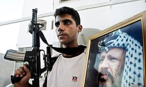 Zakaria Zubeidi (c), pictured in 2004, was previously a leader of the al-Aqsa Martyrs Brigade