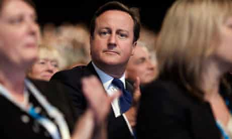 David Cameron listens to George Osborne's speech at the Conservative party conference in 2011