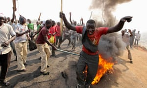 Demonstrators protest the elimination of a popular fuel subsidy near Nigeria's capital Abuja