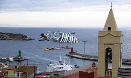 The Costa Concordia lies in the harbor of Giglio as resuce efforts continue.