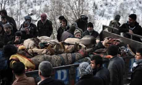 Truck carries the dead bodies of Kurdish villagers after a Turkish army attack