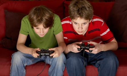 teenage boys playing computer games