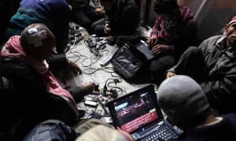 Egyptian bloggers work on their laptops, February 2011
