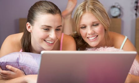 Teenage girls surfing the internet