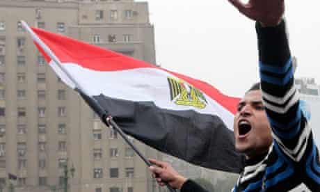 A protester in Cairo's Tahrir Square shouts anti-military government slogans, January 2012