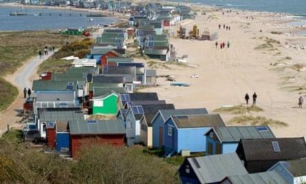 Mudeford Sandbank wooden beach houses with solar panels installed, in Dorset