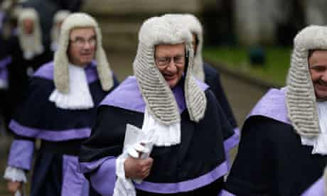 British judges leave Westminster Abbey after a religious service