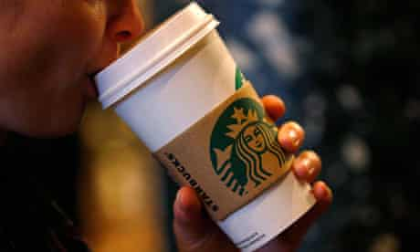 A customer sips her coffee in Starbucks' Mayfair Vigo Street branch in central London