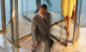 Staff walk through revolving doors