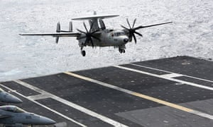 An E-2C Hawkeye aircraft lands on the USS George Washington in the South China Sea on 20 October