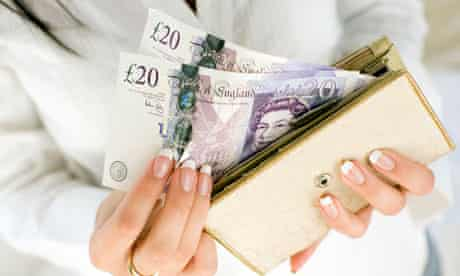 Woman with £20 notes in purse