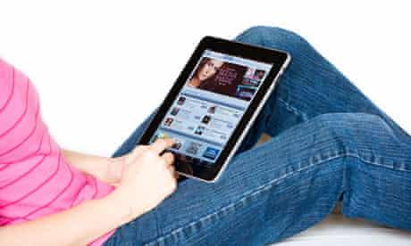 Woman relaxing using an Apple iPad shopping online