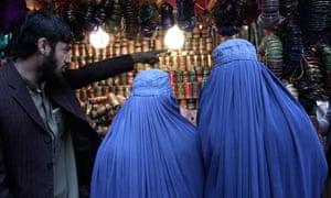 Women in Afghanistan shop at a market ahead of Eid al-Adha
