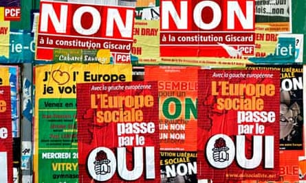Campaign posters for the European treaty are affixed in streets near Paris