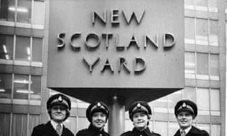Female Met officers pose in front of New Scotland Yard in 1977.