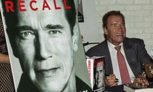 Arnold Schwarzenegger signs copies of his autobiography