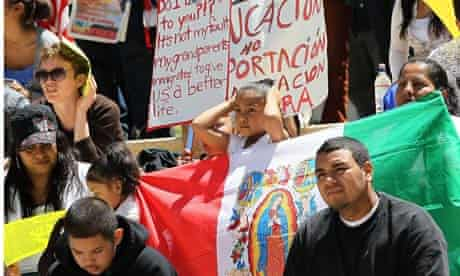 Protesters carry signs in protest of Arizona's new immigration law, April 2010